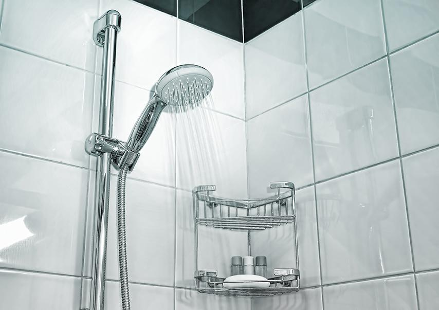 shower with a shower head pouring water
